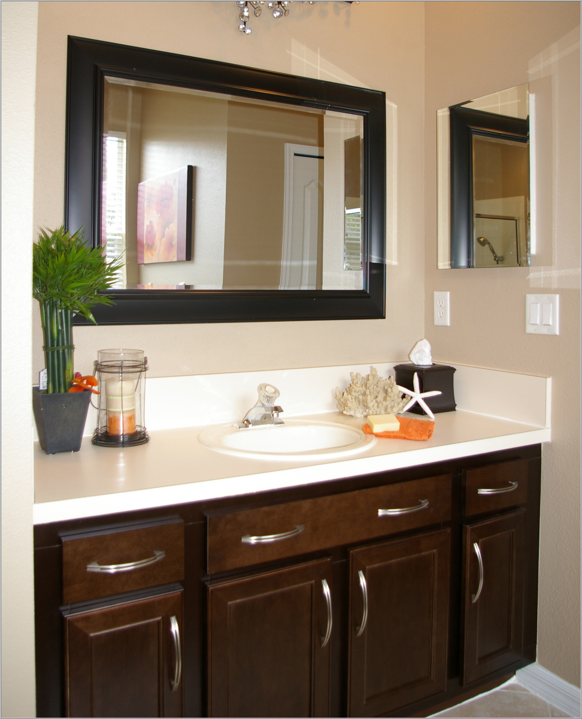 Vanity cabinets for bathroom with modern design and white marble tops