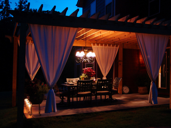 Wooden Pergola Design Plans With White Curtains and Luxury Lighting
