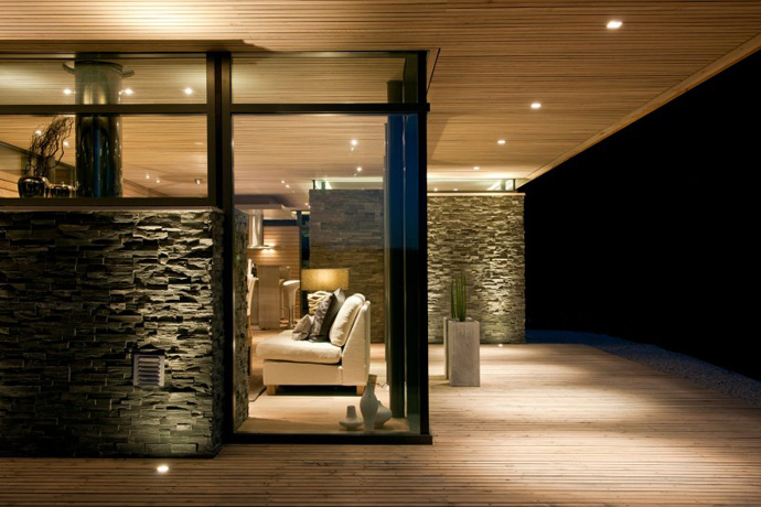 Front view of rustic house with vanity lighting