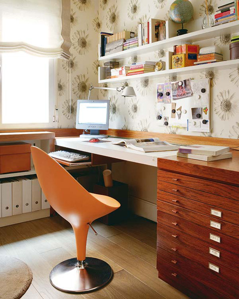 Small home office design with cool orange chair