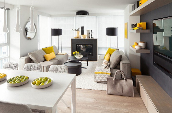 grey and yellow living room with black cabinets