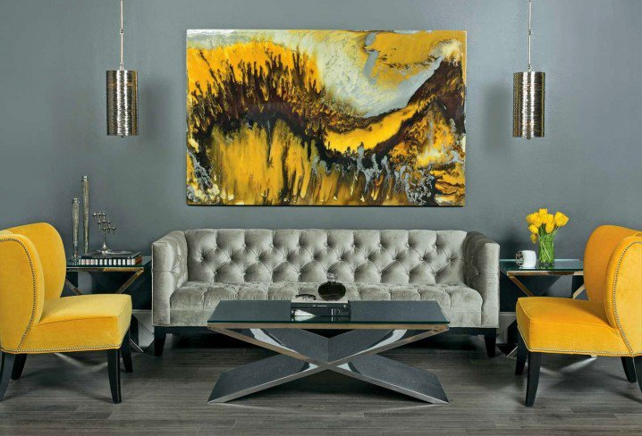 grey and yellow living room with cool black glasstop coffee table design