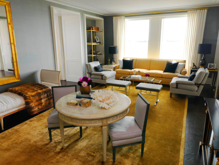 grey and yellow living room with rustic yellow carpet