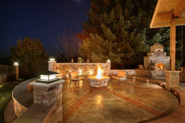 stamped concrete patio designs with with wall and wrought iron patio furniture with round firepit
