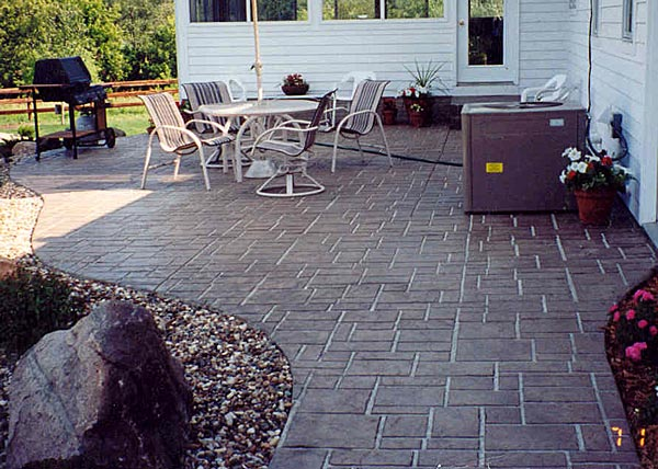 unique stamped concrete patterns for backyard landscaping with stamped concrete patio or pave and wrought iron furniture