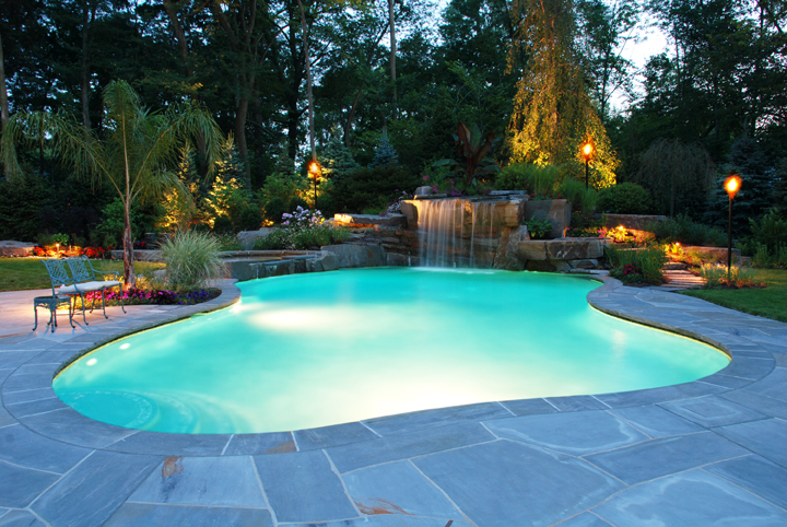 breathtaking landscape design with tiki torches and stone firepit allendale nj