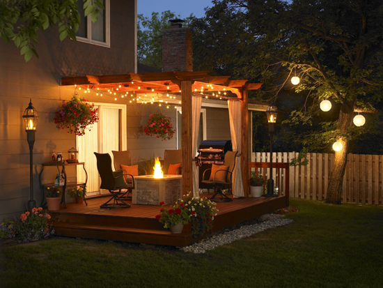 rustic outdoor lighting for small patio with fire pit and pergola