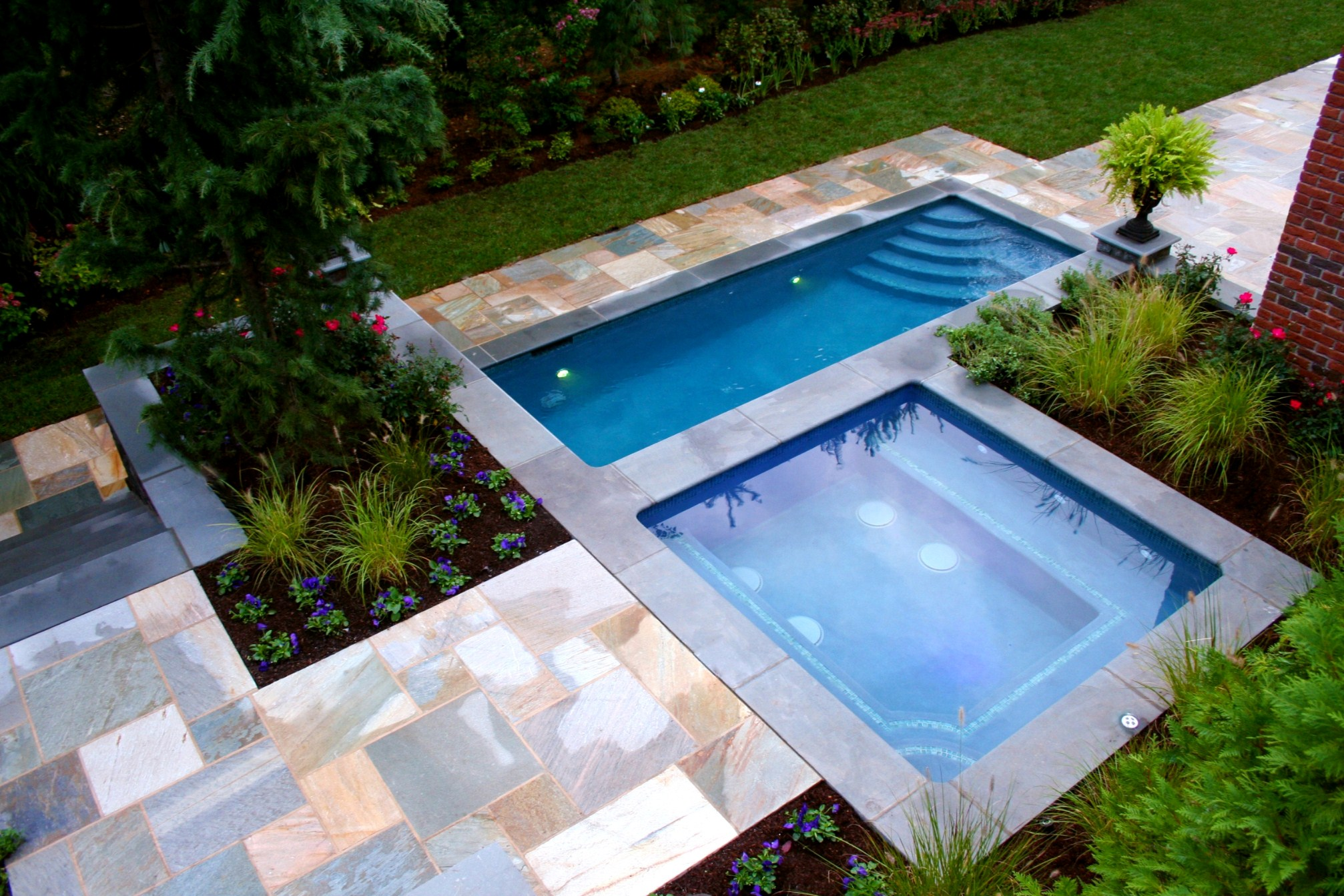 Twin Small Backyard Pool With Charming Flooring On Deck