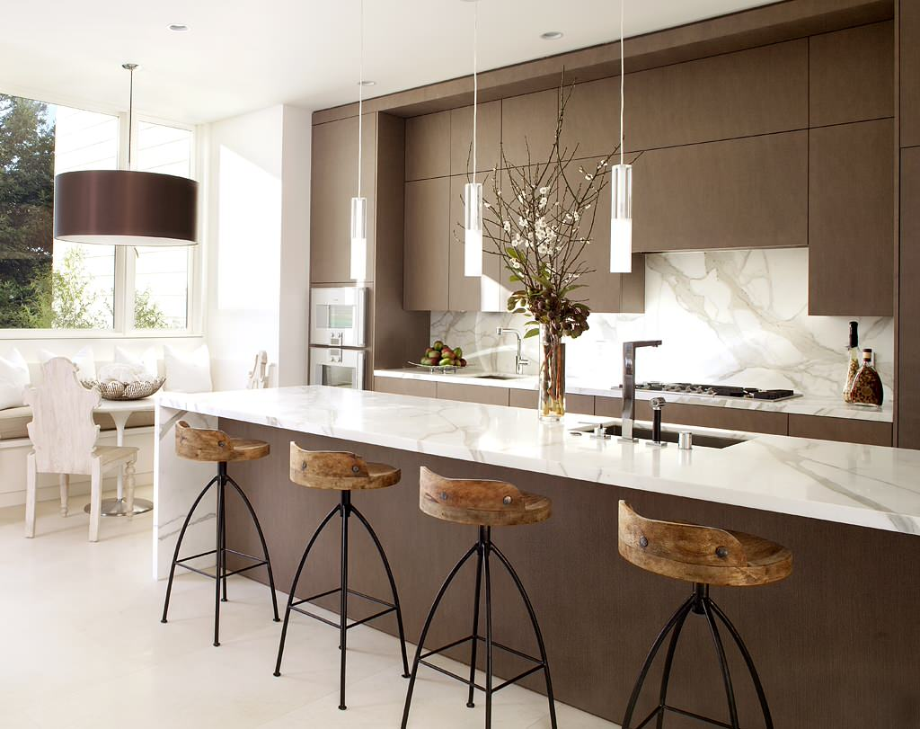 Modern Marble Countertop with Brown Cabinets In Modern Kitchen With Contemporary Counter Stools