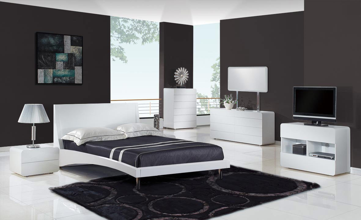 Modern luxury bedroom design in grey and white concept with modern bedroom furniture combined a big size bed with futuristic bedframe chrome legs support and black bed cover also simple small sideboard