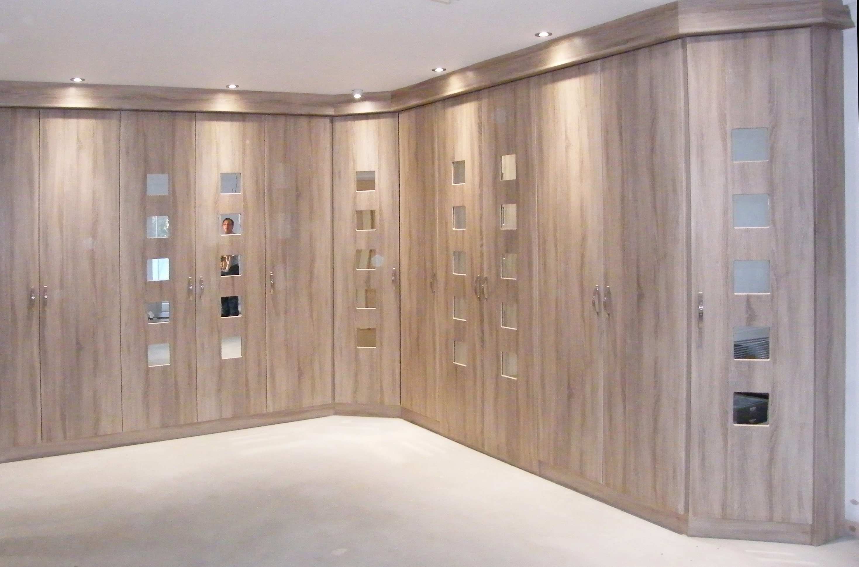 Contemporary fitted wardrobe design with sliding doors for wardrobes 3 panel with mirrored centre