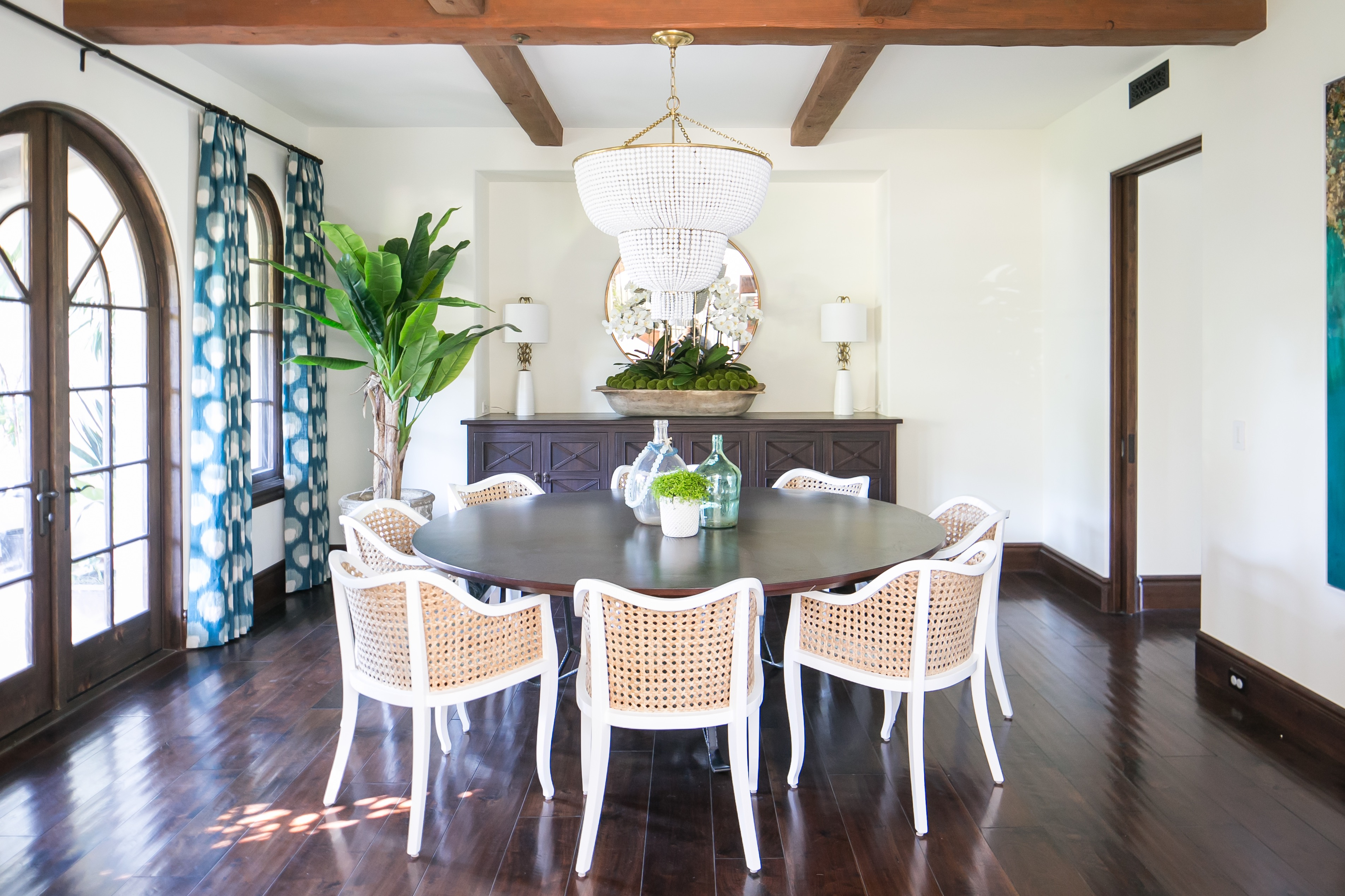 Modern Transitional Formal Dining Room With Round Dining Table Set With White Chairs