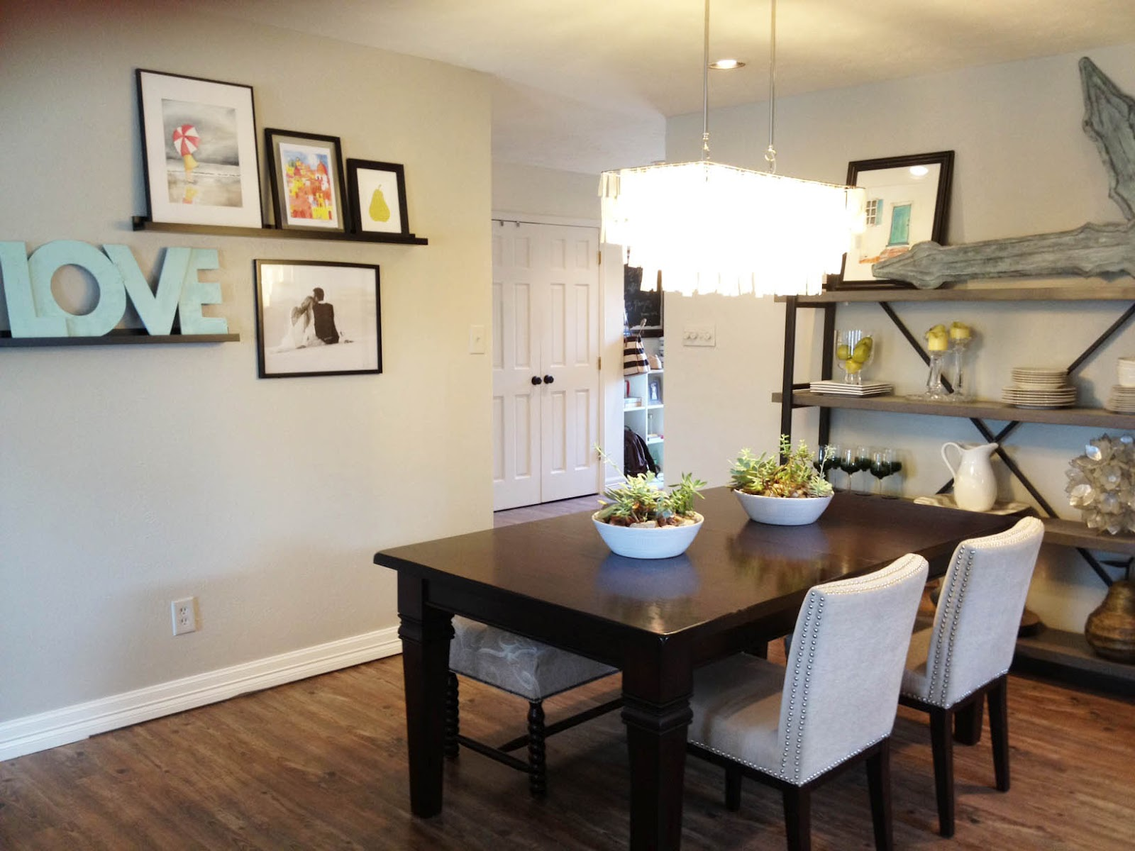 Modern chandeliers for dining room ideas over a simple wood table and white chairs
