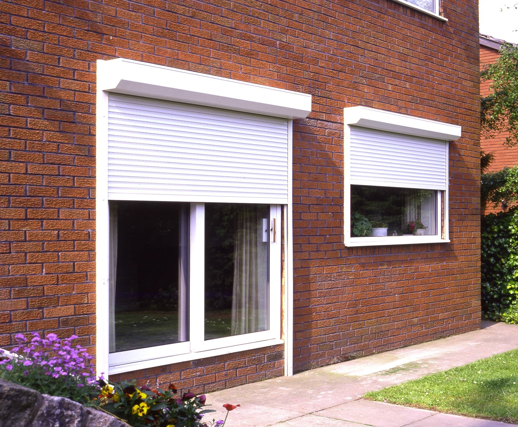 Modern exterior window shutters suitable for brick wall house