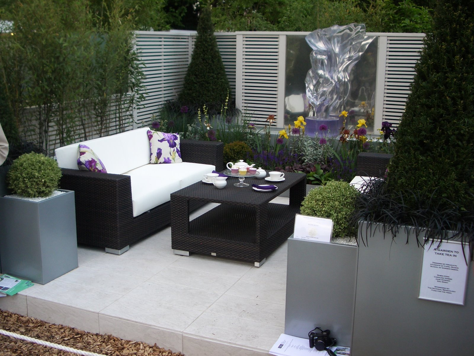 Modern black wicker outdoor furniture for outdoor patio with white cushion and cool table