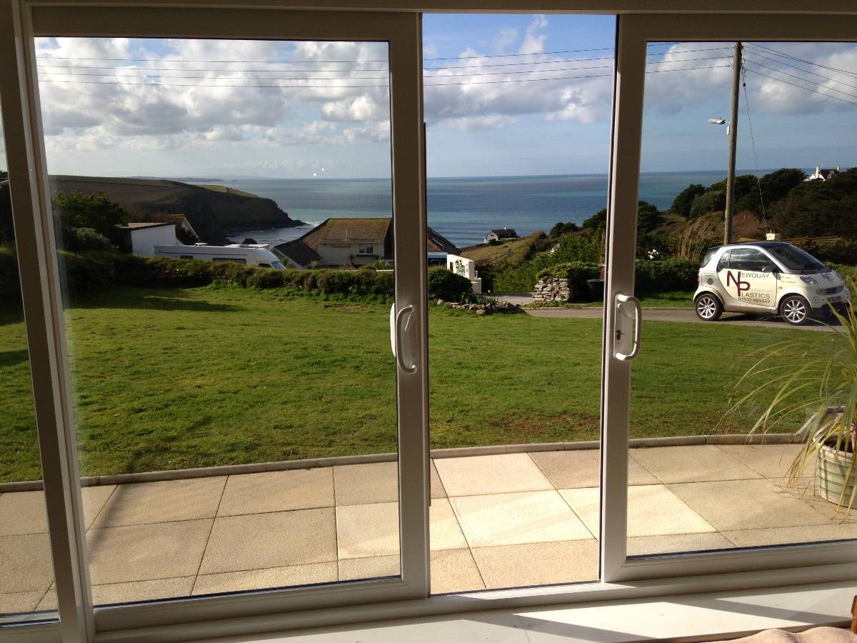 Modern sliding glass patio doors with stainless steel handle