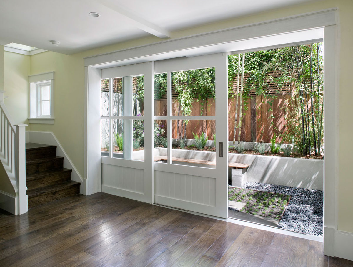Victorian style wood sliding door painted in white