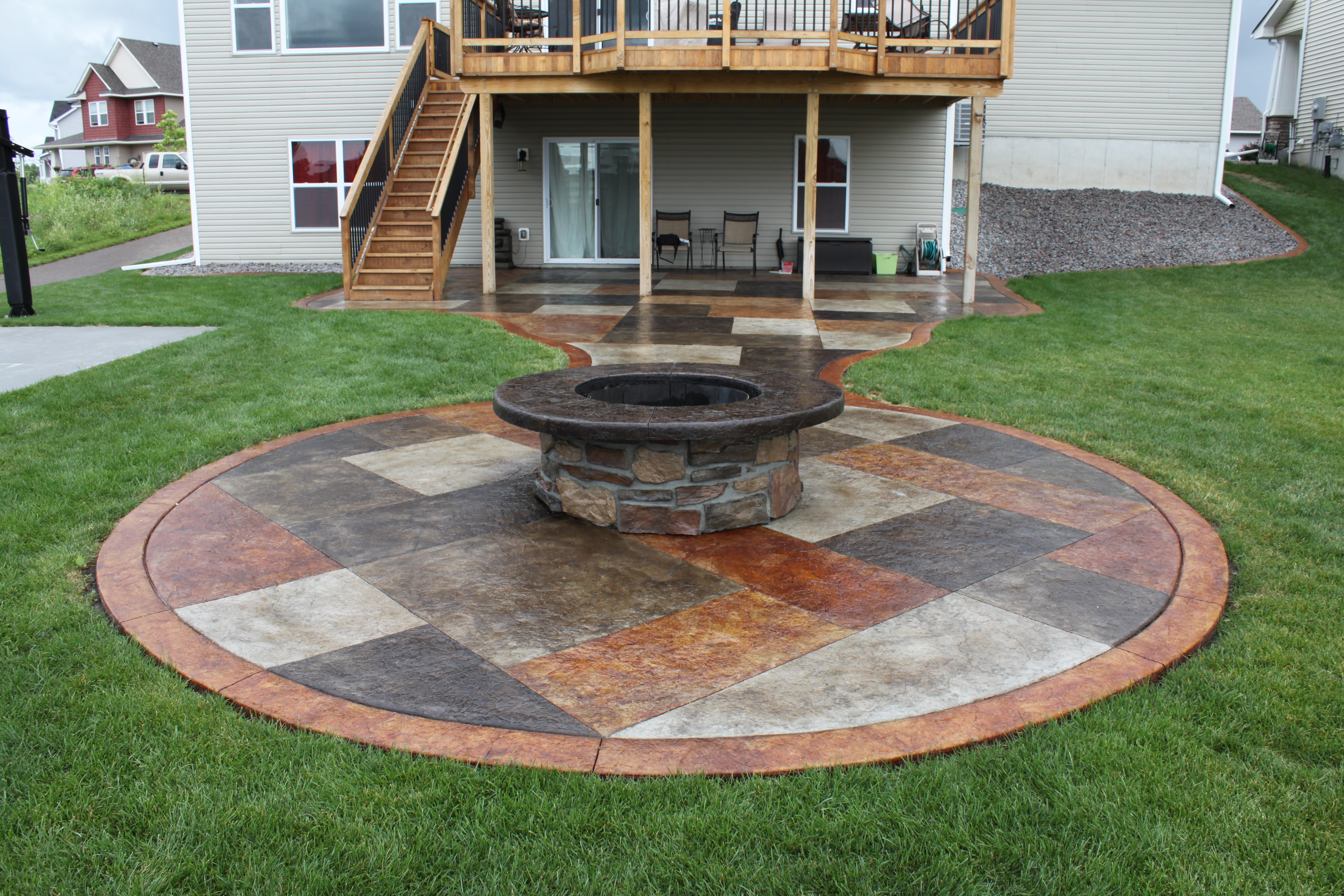 Stamped concrete patterns flooring options designs dayton ohio with brown color Stamped concrete patterns flooring options design with seating wall and fireplace